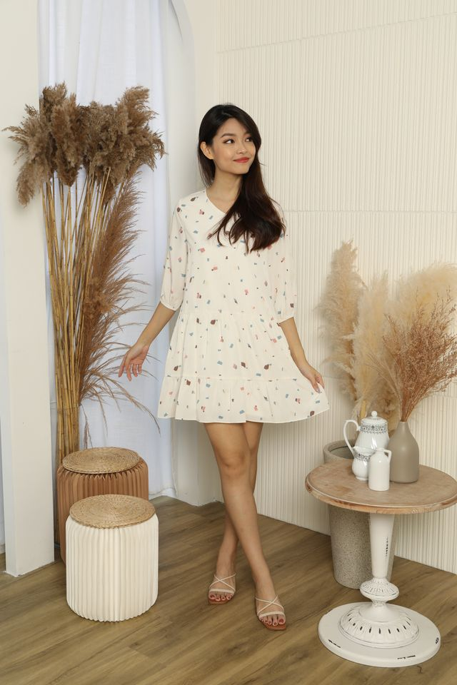 Cosette Abstract Print Tiered Babydoll Dress in Cream