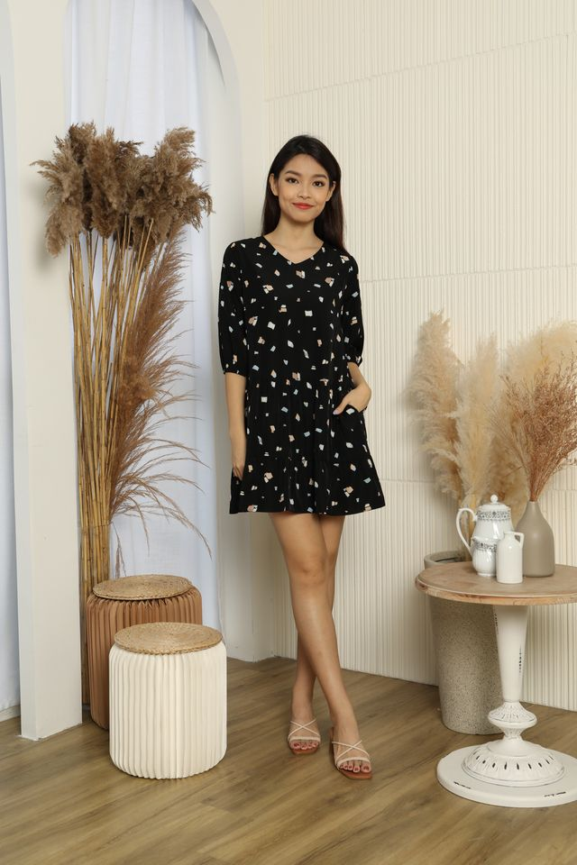 Cosette Abstract Print Tiered Babydoll Dress in Black
